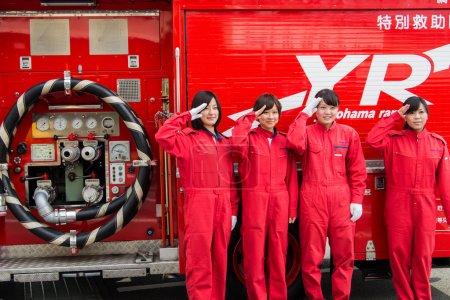 Female firefighters greet beside rescue
