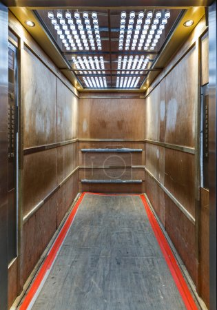 Elevator lined inside with plywood to prevent scratches