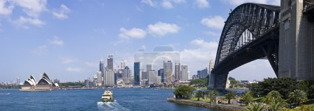 A panorama image showing Sydney Harbour Bridge and...