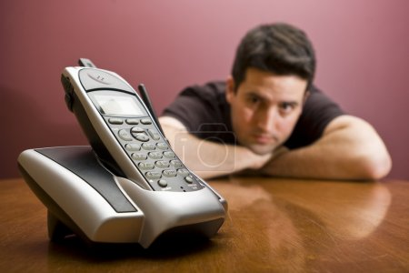 Photo for A man waits for the phone to ring - Royalty Free Image