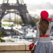 Back of beautuful woman looking at Eiffel tower, relax and enjoy her trip to France
