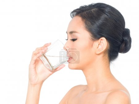 Asian woman drinking a glass of water