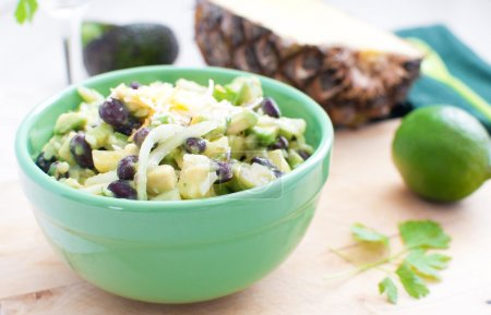 Salad with avocados, pineapple, black beans
