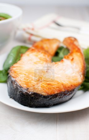 Photo for Broiled salmon steak on plate vertical - Royalty Free Image