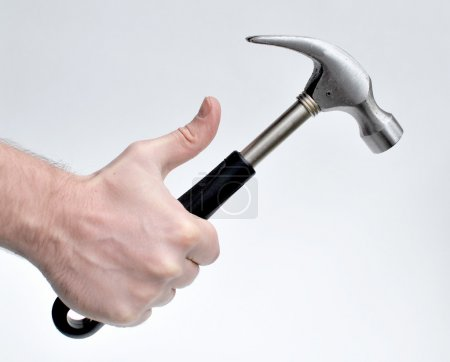 Photo for Man holding hammer - Royalty Free Image