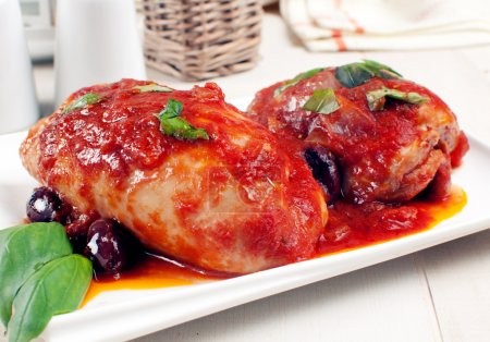 Chicken thighs or breasts in tomato sauce