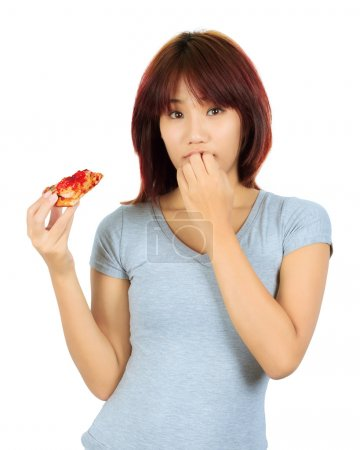 Young asian woman with a piece of pizza