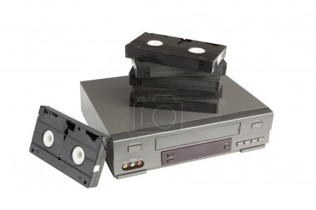 Stack of videotapes on videorecorder isolated on w...