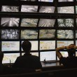 Security guards watching video monitoring surveill...