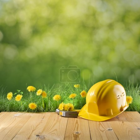 construction helmet on green nature background