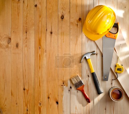Photo for Wood texture with construction tools, helmet, paint and brush - Royalty Free Image