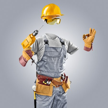 invisible worker in helmet with drill