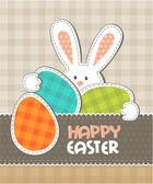 Greeting card Easter bunny with colored eggs