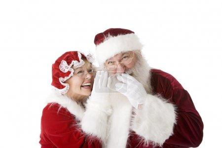 Photo pour Noël Père Noël chuchotant et gloussant avec Mme Noël - image libre de droit