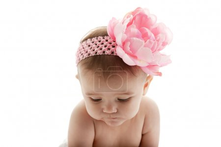 Sweet baby girl wearing a headband with a big flower