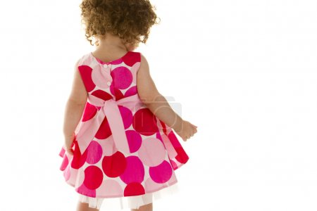 Toddler baby girl with curly hair