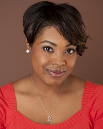 Head shot of a beautiful smiling black woman