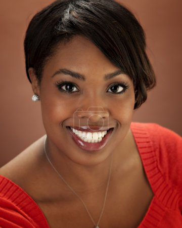 Head shot of young smiling black woman