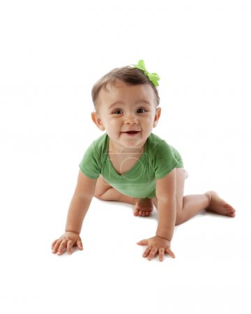 Mixed race baby girl crawling on the floor