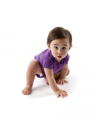 Baby girl wearing T-shirt crawling