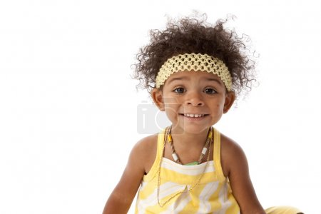 Toddler girl smiling with surprise on her face