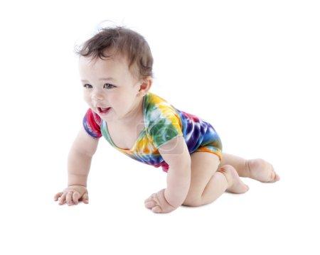 Toddler baby boy crawling in tie dye undershirt