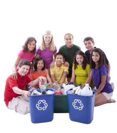 Diverse preteens of mixed ethnicity working together to recycle