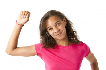 Mixed race girl cheers and raises her hand