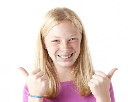 A preteen girl giving her approval with a thumbs up