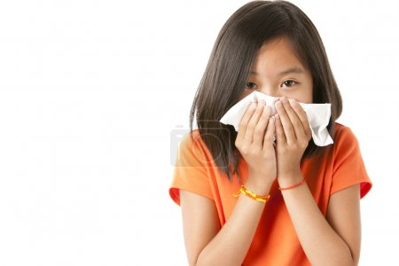 Asian little girl with the flu or allergies
