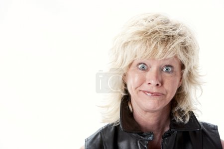 Caucasian mid adult woman with disappointed expression on her face