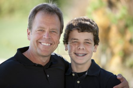 Caucasian family with father and his teenage son