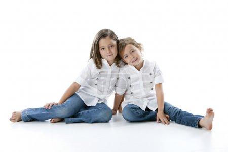 Full length image of two smiling caucasian little girls
