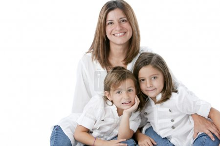 Waist up image of smiling hispanic mother and daughters