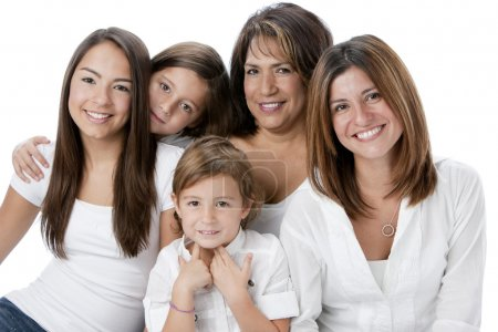 Waist up image of smiling hispanic family with mothers and daughters