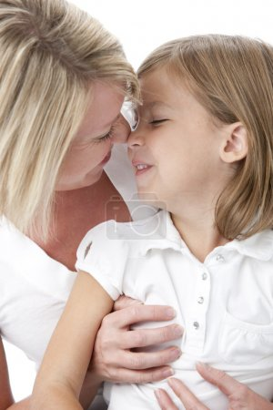Full frame image of mother and daughter affectionately rubbing noses