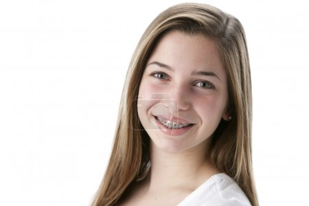 Headshot of smiling caucasian teenage girl