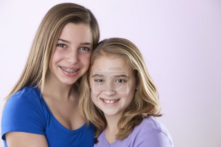 Image of two caucasian sisters