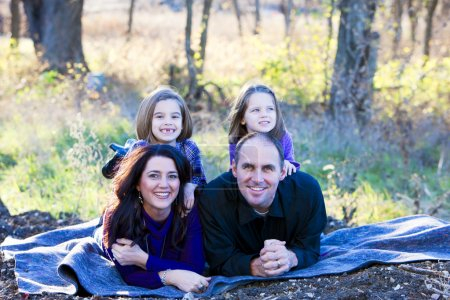 Full length image of a caucasian family outdoors