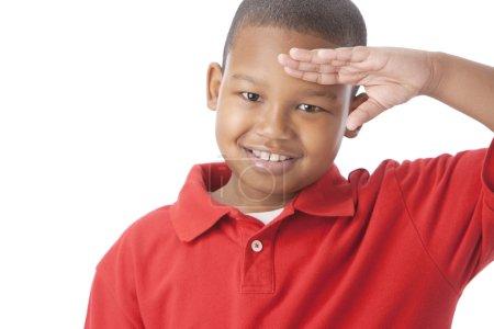 African american little boy saluting patriotically