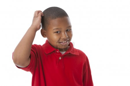African american little boy scratching his head as if he is thinking or confused