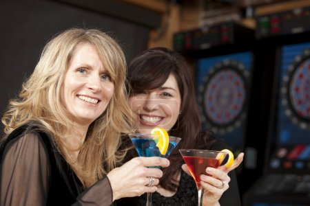 Caucasian adult women enjoying a girls night out together at a restaurant bar and grill.