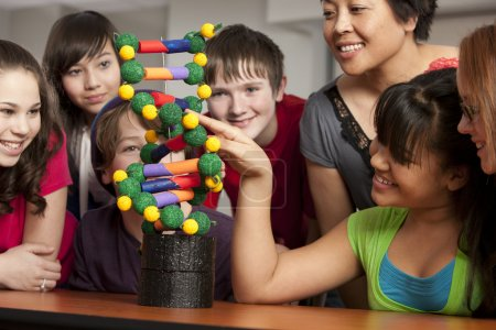 School Science. Students in the school classroom learning about science and DNA.