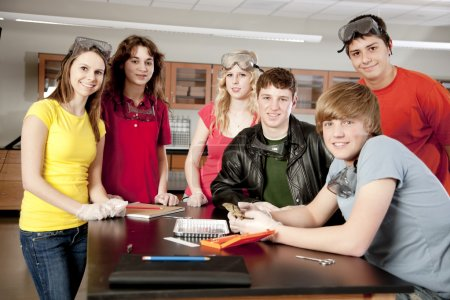 School Science. High school students wearing safety equipment