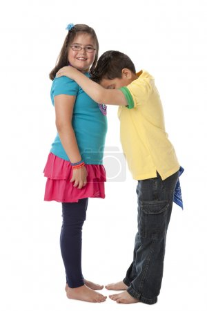Photo for Multicultural children work together to form the letter D. - Royalty Free Image