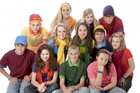 Diversity. Group of teenage girls and boys sitting together in colorful clothes