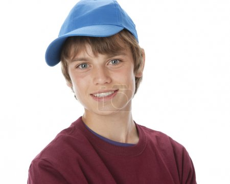 Real. Caucasian teenage boy wearing vibrant colorful clothes and a baseball cap