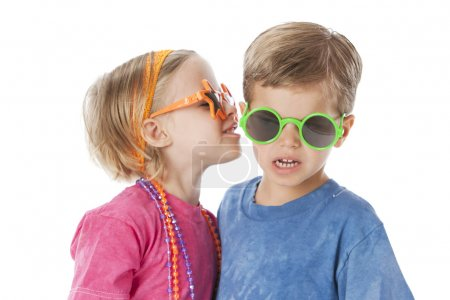 Real. Caucasian twins a little boy and little girl wearing silly sunglasses