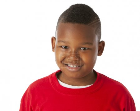 Real. Black little boy wearing a bright red shirt with his head shaved
