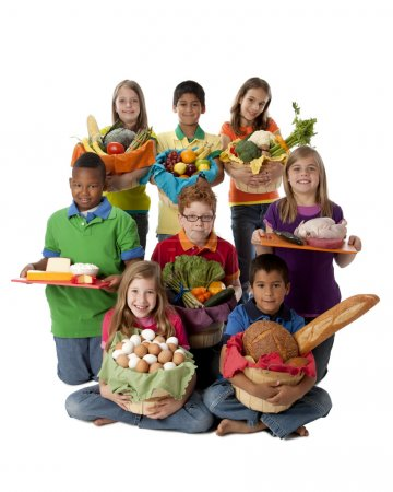 Healthy Eating. Group of children holding baskets with a variety of healthy food